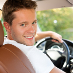 bigstock-Driver-is-sitting-in-his-car-o-23913188