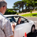 bigstock-Learner-driver-girl-with-instr-43914073
